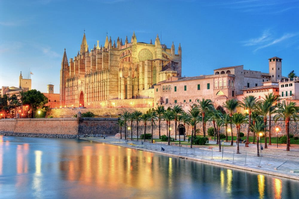 Cathedral of Palma de Majorca reflecting on the water at evening